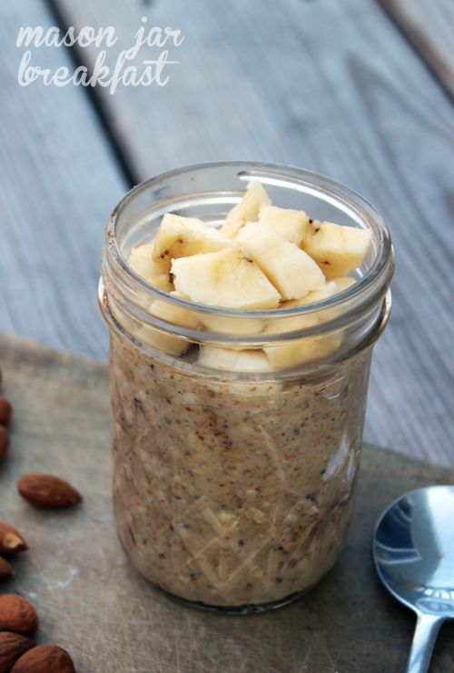almond butter overnight oatmeal in a Mason jar topped with bananas